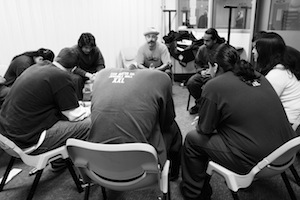 Vinny Ferraro (center, wearing hat) of the <a href=&#8220;http://www.mbaproject.org/&#8221;>Mind Body Awareness Project</a> leads a workshop at a juvenile hall in the Bay Area.