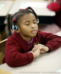 A student participating in the Mindful Schools program.