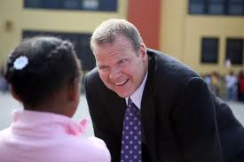 Former Oakland Unified School District Superintendent Tony Smith with student