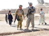 A U.S. and a British soldier in Kandahar province, Afghanistan on Nov. 16, 2010, during the Afghan holiday Eid-al-Qorbon, a celebration of forgiveness, friendship and peace.