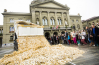 Swiss proponents of basic income dump 8 million coins in a public square, one for each Swiss resident.