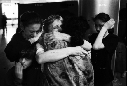 Women and children are reunited with their families after being imprisoned by Serb authorities during the Bosnian civil war