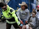 Carlos Arredondo helps a victim of the Boston Marathon bombing in April 2013. After Tsarnaev was sentenced to death, Arredondo expressed profound ambivalence about the verdict.