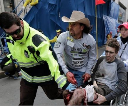 "Carlos Arredondo helps a victim of the Boston Marathon bombing in April 2013. After Tsarnaev was sentenced to death, Arredondo <a href=""https://www.youtube.com/watch?v=235xD5dfNoY"">expressed profound ambivalence</a> about the verdict."