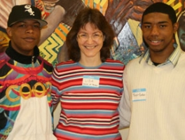 Lisa Calderone-Stewart (center) with two graduates of her program, Ryan (left) and Marquis.