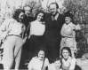 Oskar Schindler (back row, second from right) with people he rescued from the Holocaust, one year after the end of World War II.
