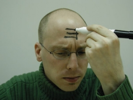 In one recent study, participants made to feel powerful were three times more likely than others to write an E on their forehead so it was forwards to themselves but backwards to others (right), suggesting they were less likely to consider other people's points of view.