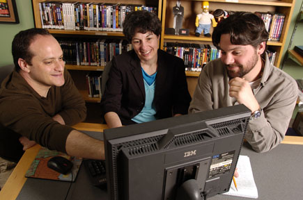 PeaceMaker video game co-producers Asi Burak (left) and Eric Brown (right), with Laurie Eisenberg, a professor at Carnegie Mellon University who has served as an advisor on the game