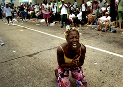A woman begs for help in the wake of Hurricane Katrina