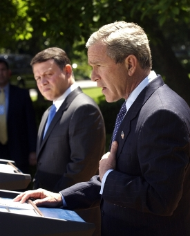 Jordan's King Abdullah II and President Bush in the White House Rose Garden discussing the abuses at Abu Ghraib prison with the media on May 6, 2004.