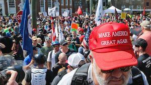 A white nationalist demonstrator walks into Lee Park in Charlottesville, Va., Saturday, Aug. 12, 2017.