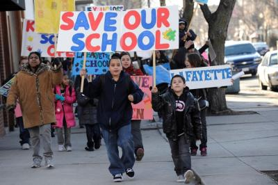 Students in Chicago protest the closing of their elementary school—one of 50 slated for closure by the city.