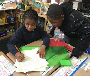 Fourth-graders at P.S. 67 often work in groups. They are asked to write several drafts of essays to get used to revising their work.