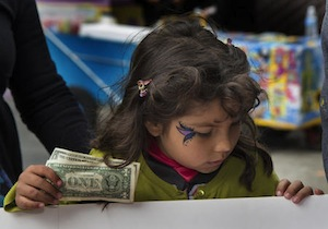 A child buys tickets at the Halloween-Día de los Muertos fundraiser for Junipero Serra Elementary in San Francisco.