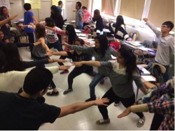 Students practicing yoga