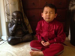 The author&#8217;s younger son striving to achieve the same &#8220;inner peace&#8221; as his hero, <em>Kung Fu Panda</em>.