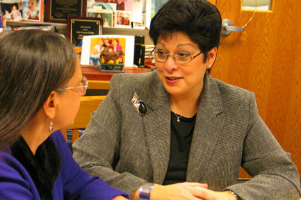 Linda Lantieri (left), the founder of Project Renewal, with high school principal Ada Rosario Dolch.