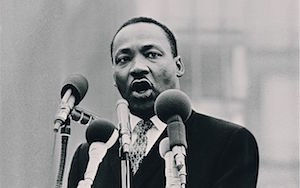 """I refuse to accept the view that mankind is so tragically bound to the starless midnight of racism and war that the bright daybreak of peace and brotherhood can never become a reality.""—Martin Luther King Jr."