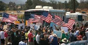 Protesters turn back three buses containing migrant families as they attempt to enter the Murrieta Border Patrol station on July 1.