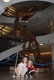 The author's daughters in front of the T. rex replica on the UC Berkeley campus.