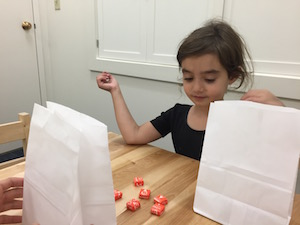 Matilda thinks about how many Starburst she's willing to part with in a study from Boston and Yale Universities exploring how gratitude affects children's sharing.