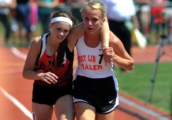 Runner helps cross finish line