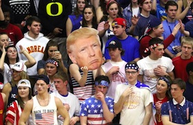 "White high school students hold up a picture of Donald Trump and chant ""build a wall"" during a basketball game against a predominantly Latino school in Indiana."